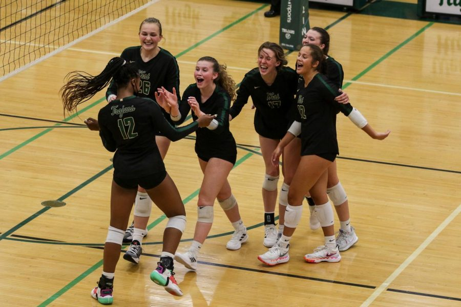 Sophomore Malae Lacy is congratulated by her teammates after a big kill against Xavier on Aug. 31.