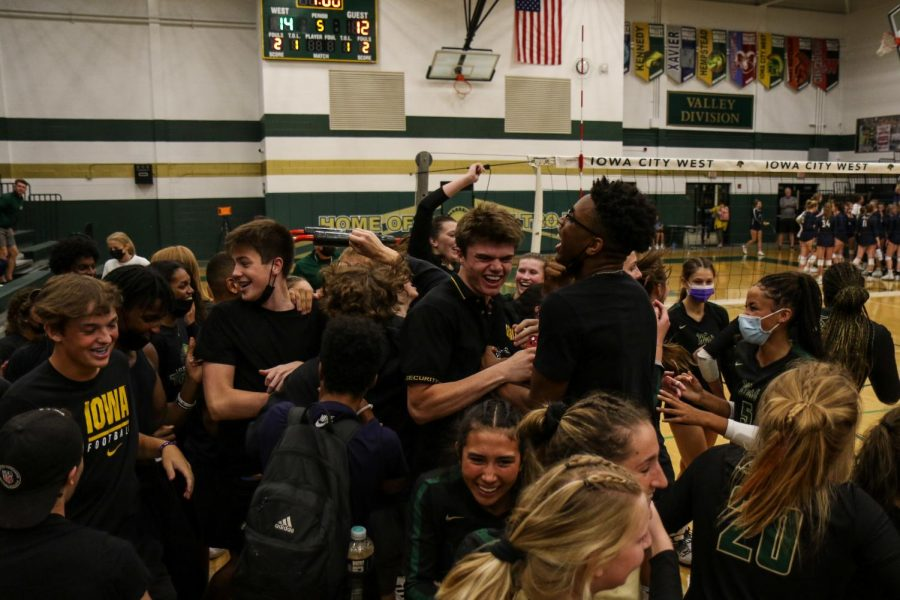 The student section and volleyball team celebrate on the edge of the court after after defeating Xavier on Aug. 31.