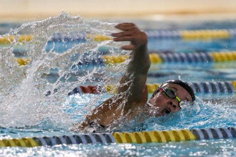Jade Roghair 23 takes a breath as she swims in the 500 yard freestyle on Sept. 2 in a dual meet against Waterloo at the Coralville Rec Center.