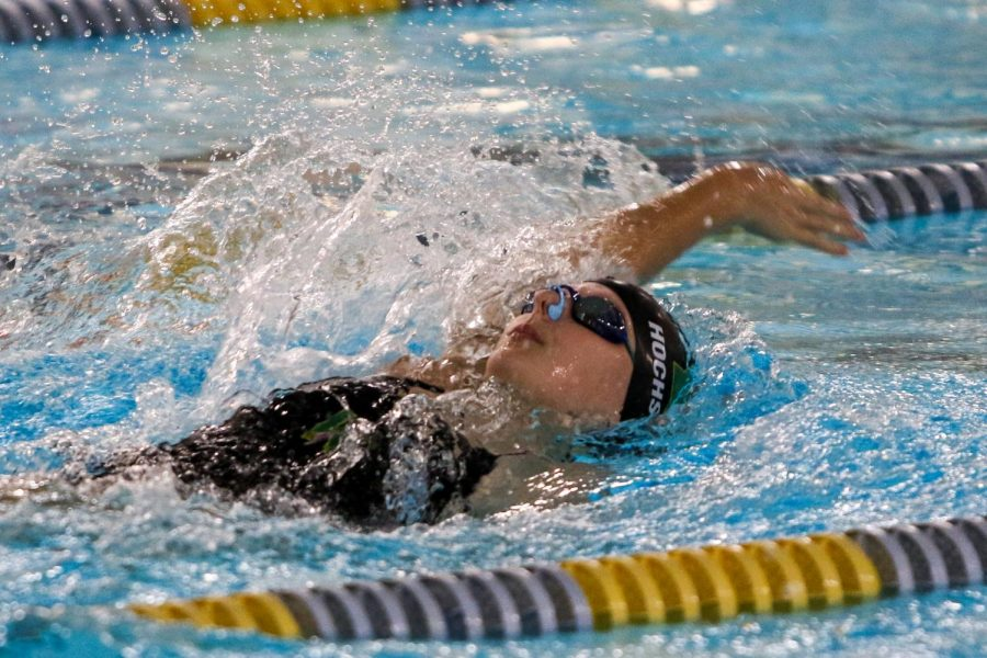 Ella Hochstetler 22 swims in the 100 yard backstroke on Sept. 2 in a dual meet against Waterloo at the Coralville Rec Center.