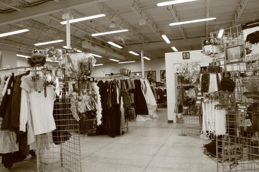 The front display of Goodwill Iowa City. Each corner features a different Halloween section. The right side has Halloween decor and props. The left side has an assortment of clothing items.