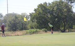 Cole Eberly 22 watches his put closely