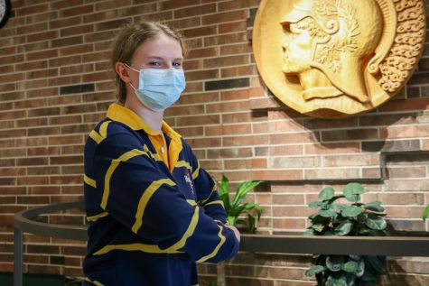 Laney Prelle 23 poses in front of her new schools mascot.