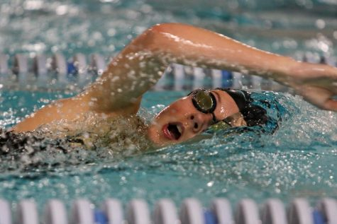 Hope Eldridge 22 takes a breath while swimming in the 400 yard freestyle relay on Oct. 19 during a dual meet against City High.