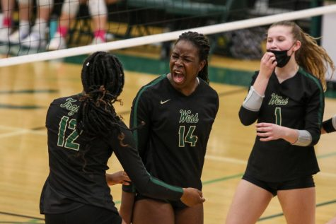 Mayowa Dokun 22 celebrates a kill with Melae Lacy 24 on Oct. 21 during the regional semifinal against Bettendorf.
